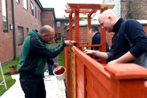 Volunteers taking part in the Give a Day to Carlisle scheme, helping to create an outdoor barbeque area for staff and residents at the Water Street Family Accommodation, pictured out in front making use of their painting skills are Ian Jackson, left, and project manager Matthew Bond from Cito Cleaning, 3 October 2015 LOUISE PORTER 50080543F006.JPG