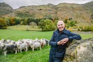 Chris-Monks-with-a-flock-of-Herdwick-sheep-at-Fornside-Farm-St.-Johns-in-the-Vale.-Photography-by-Steve-Barber.